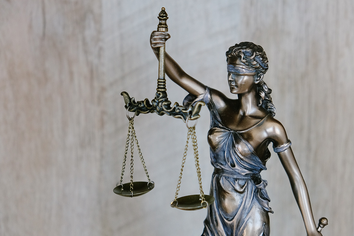 law and order lady justice Justitia blindfolded and holding a balance and a sword interrnational attorneys litigations and law firms, indian corruption,Corruption and legal india Judiciary